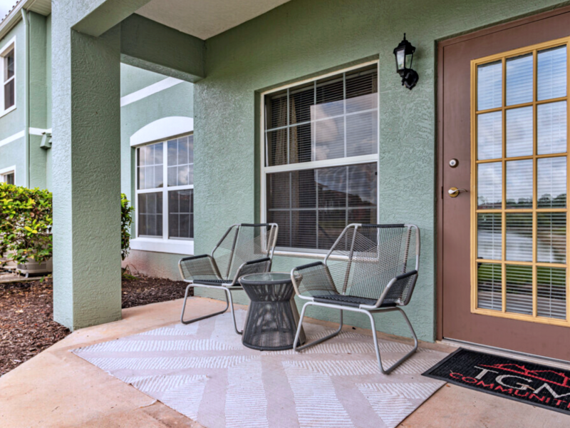 This image shows the balcony with a café table and a chair. You can always have a cup of coffee here while enjoying the scenic view outside.